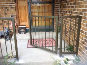 Front-gate-with-rail-scaled.jpg